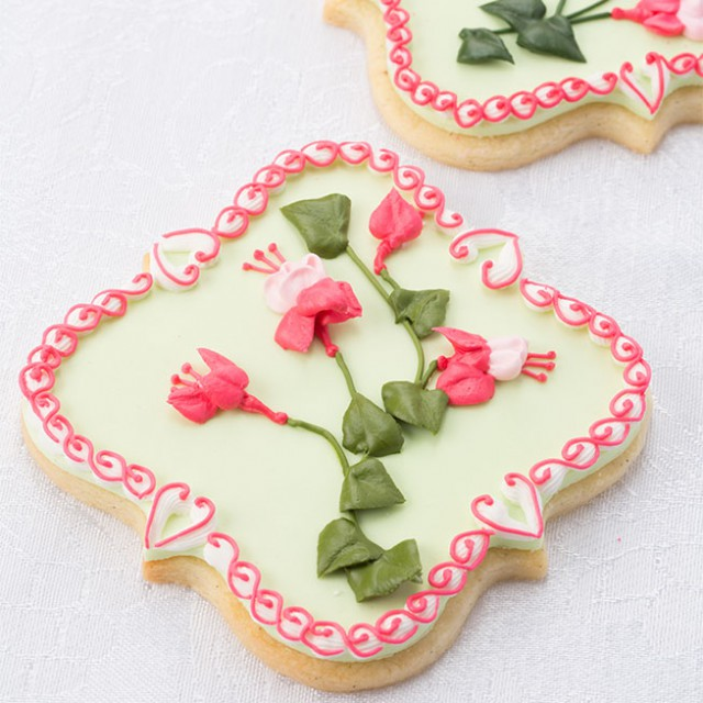 Royal Icing Fuchsia Flower Spray Piped On A Sugar Cookie