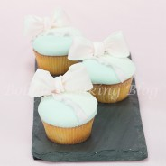 White Chocolate-Limoncello Cupcakes with a Kiss Surprise
