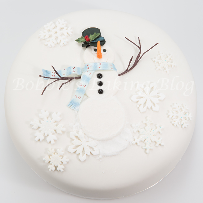 Learn how to create alan dunn's  sugar snowman cake