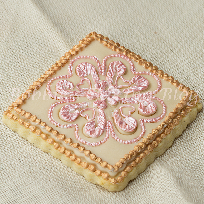 how to pipe royal icing broderie anglaise with Bobbie video