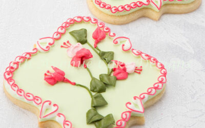 Learn to Pipe Royal Icing Flowers on a Sugar Cookie